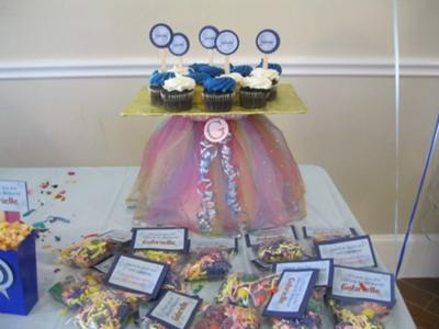 Butterfly theme cupcake stand with goody bags